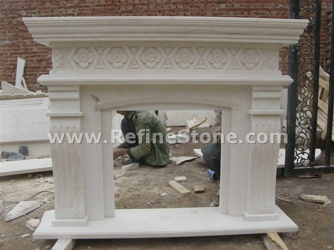 Marble fireplace with carved