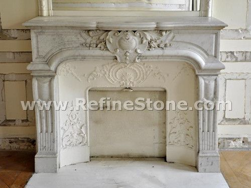 Highly carved carrara marble fireplace