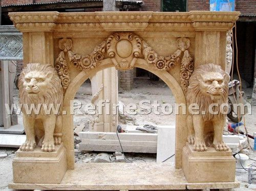 Yellow limestone fireplace with lion sculpture